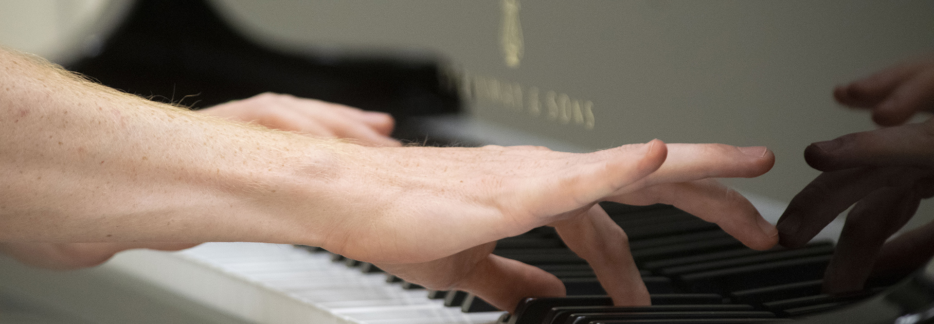 Dr. Fountains Hands playing the piano