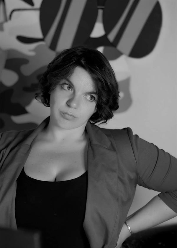 Portrait of a women standing in an art studio