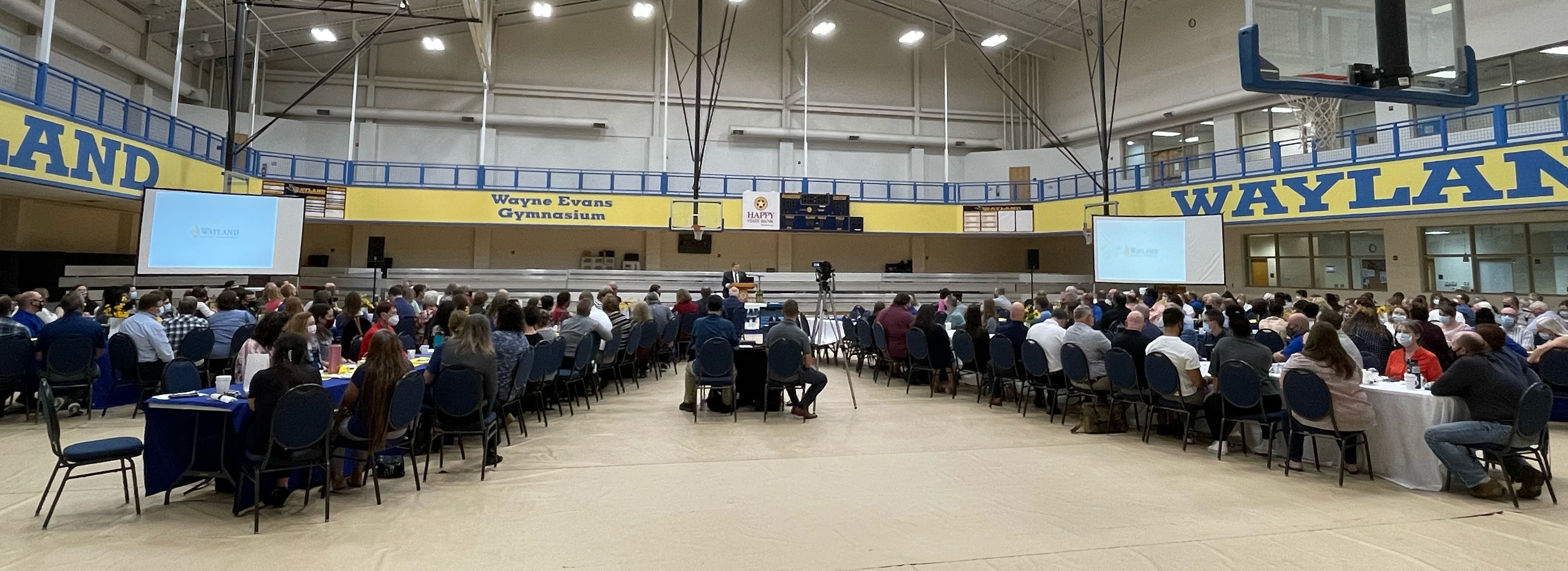 Wayland faculty and staff gather in the Laney Center