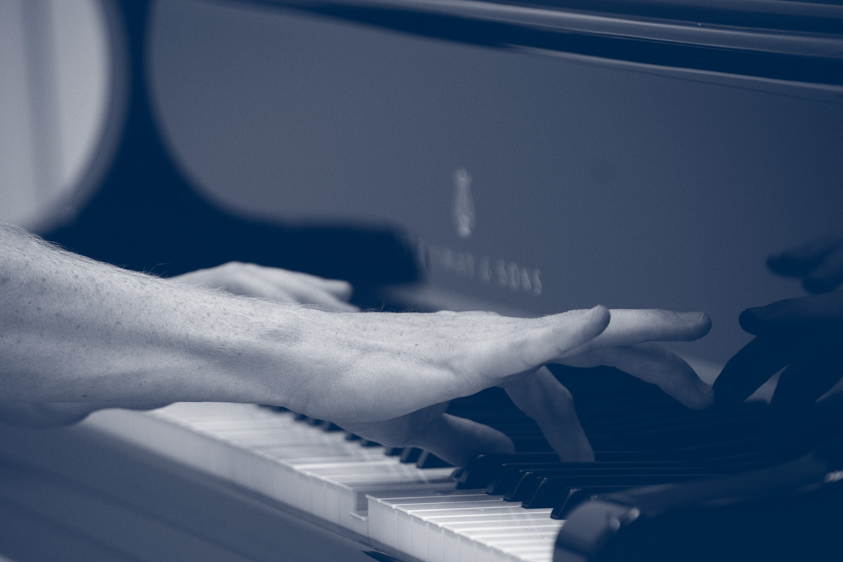 hands playing a piano