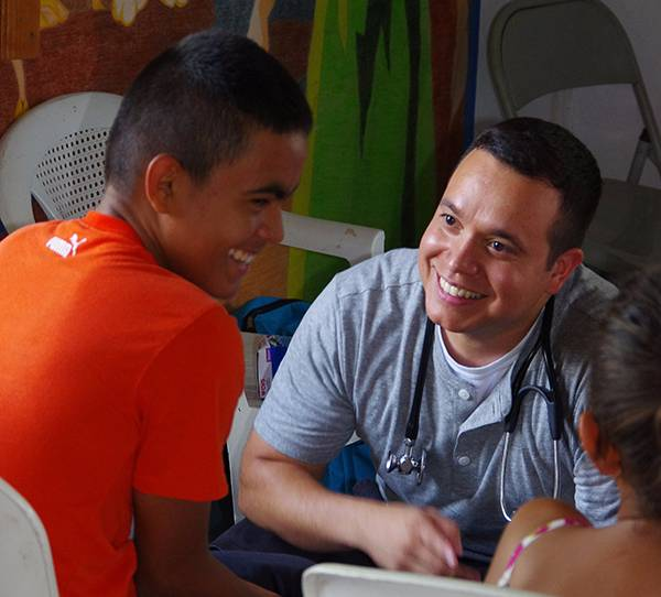 Martin Ortega smiles as he speaks to a child in Honduras.