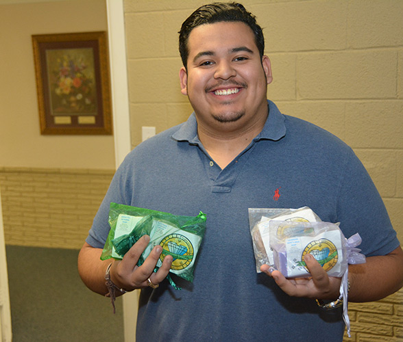 Obit Medina displaying soap made by clients at Central Plains Center.