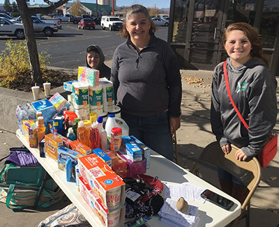 Ronnie Arrington (center), son Tyler and daughter Kestra man a table outside a local store to collect items for a homeless shelter in Delta, Colo., where the family serves as church planters through the North American Mission Board.
