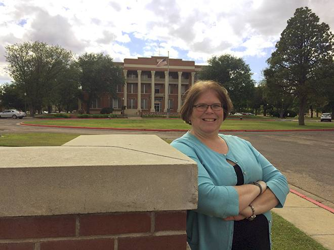Teresa Young stands in front of Gates Hall.