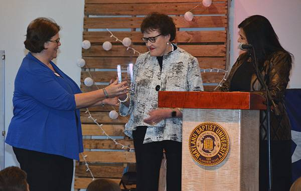 Dr. Glenda Payas receives her award from Teresa Young.